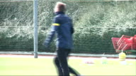 Arsenal train before Champions League match ENGLAND Hertfordshire London Colney EXT Arsenal Manager Arsene Wenger along at training ground / Per...