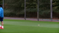 Hertfordshire London Colney EXT Arsenal players and Arsene Wenger arriving on pitch / general views of training session including Jack Wilshere