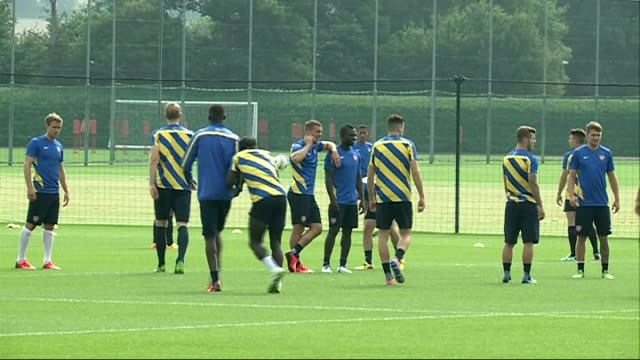 Hertfordshire London Colney EXT Arsenal players on pitch / Arsene Wenger arriving for training sesssion / General views of Arsenal players training