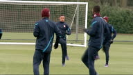 Arsenal training Further shots of Arsenal players jogging and warming up including close shots of Theo Walcott Thierry Henry Robin Van Persie and...