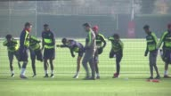 Arsenal training More of Arsenal players stretching and warming up / Players doing passing drills