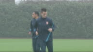 Arsenal training session Further shots of Arsenal players jogging and doing warmup exercises on training pitch including close shots of Ju Young Park...