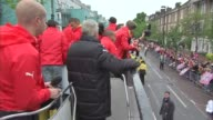 London Islington EXT Per Mertesacker interview / various of players on bus and fans lining the route / Theo Walcott interview / various of players on...