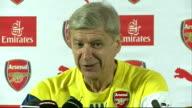 Arsene Wenger press conference on Danny Welbeck signing ENGLAND Hertfordshire London Colney INT Arsene Wenger into press conference and taking seat...