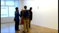 London D'Offay Gallery Gallery visitors looking at sculptures by Ron Mueck Andy Warhol selfportrait on display Anthony d'Offay interview SOT I think...