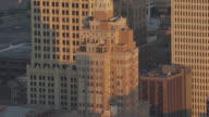 WS AERIAL Art Deco buildings in downtown at sunset / Tulsa, Oklahoma, United States