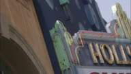 Art Deco styles adorn the facade of a Hollywood theater.