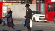 Art project in jewish neighbourhood backfires with accusations of Antisemitism ENGLAND London Stamford Hill EXT Hasidic Jewish man crossing road