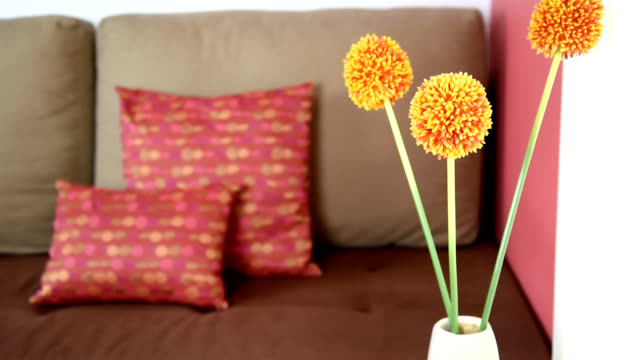 Artificial flower over partial of sofa in modern Living room / interior design & renovation conceptual