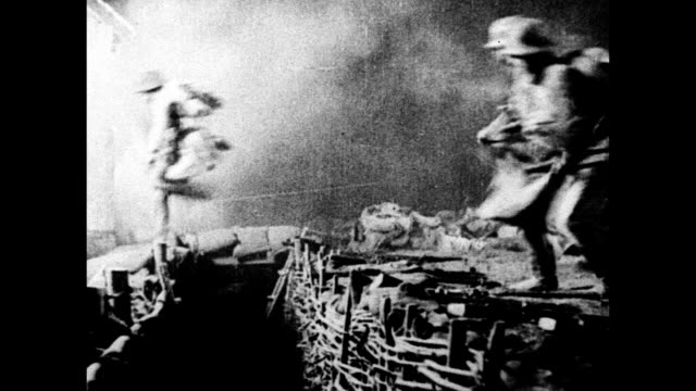 Artillery firing German soldiers jumping over trench NIGHT BEHIND Flamethrower HA XWS Open area on covered in smoke NIGHT Bricks charred WWI Germany...