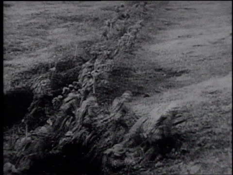 artillery firing / troops running into a field from a trench / artillery firing / explosions in a field / biplanes flying in the sky / explosions in...
