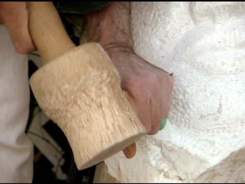 Artisan Sculptor Carving Stone