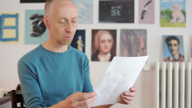 Artist analyzing a draw.