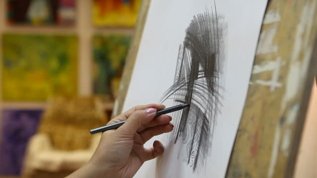 Artist drawing in studio (HD)