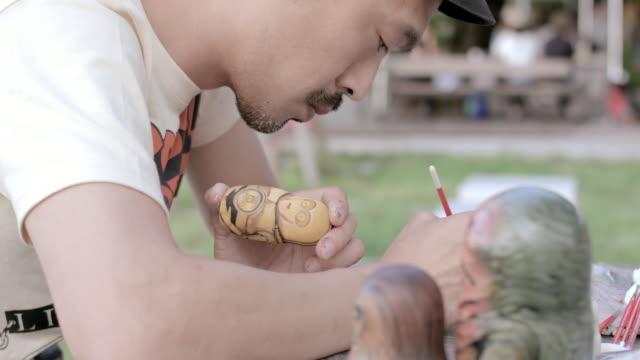 CU Artist making Matryoshka doll at the park / Nerima, Tokyo, Japan