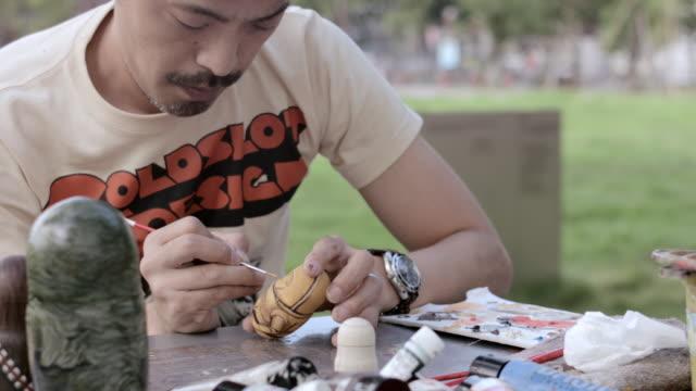 MS Artist making Matryoshka doll at the park / Nerima, Tokyo, Japan