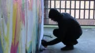 Artist paints at abandoned cold war NSA spying site in Teufelsberg also known as 'Devil's Mountain'