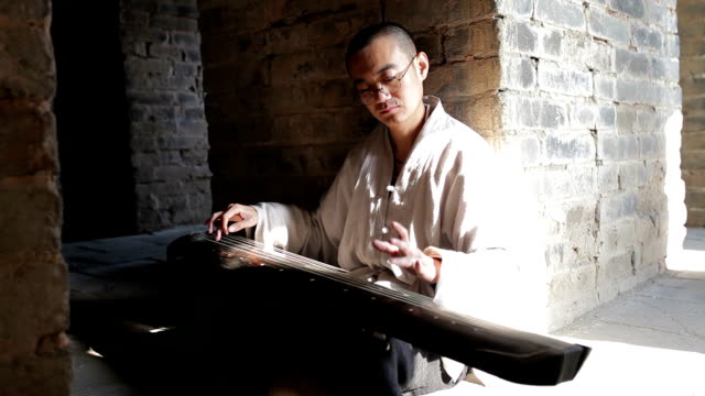 Artist playing the Guqin in Great wall of China