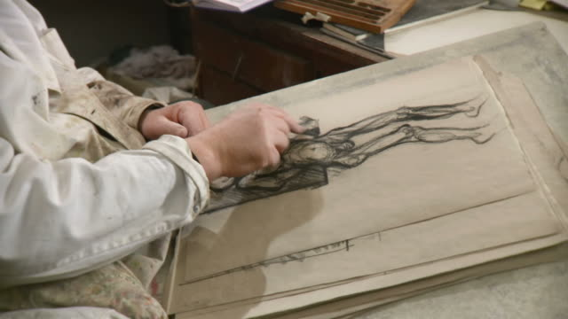 HD DOLLY: Artist Sketching Draft On A Paper