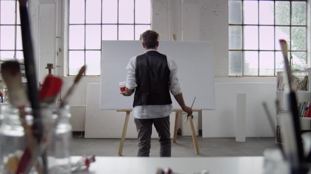 Artist starts painting on canvas