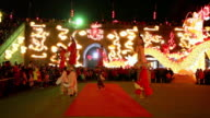 MS PAN Artists carry children dressed as ancient figures during shehuo performing at city wall new year lantern festival, Shehuo is traditional festive folk celebration during chinese spring festival AUDIO / xi'an, shaanxi, china