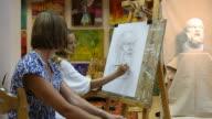 Artists drawing in studio (HD)