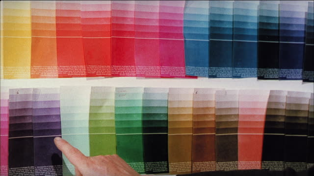 MONTAGE Artists looking over color swatches (color shift in film is intentional/experimental) / United Kingdom