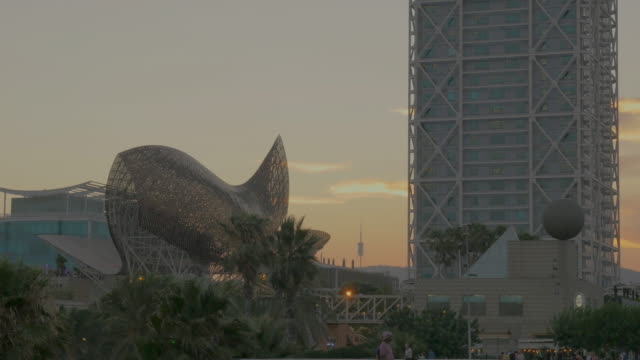 Arts hotel and the fish in Barcelona's Port Olimpic during sunset