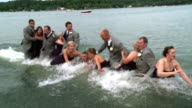 / as a wedding party is taking photographs on a dock the dock collapses and the entire party falls into the lake Wedding Party Blooper on June 23...
