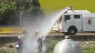 As antigovernment protesters vowed to march to a key military installation in Venezuela on Friday riot police fired tear gas and water cannon to...