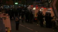 As dusk falls, riot police maintain a blockade barring unionist/loyalist protesters from entering a predominantly Catholic and traditionally nationalist area of Belfast in an attempt to stop sectarian violence, July 2015, Northern Ireland.