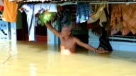As floods which have swamped parts of the Philippines and affected more than two million people extend into their second week the dead and the living...