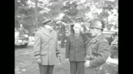 As Korean Army band plays US Lt Gen Walton Walker comes into scene and stands next to conductor / VS Walker unid Korean conductor Korean leans in to...