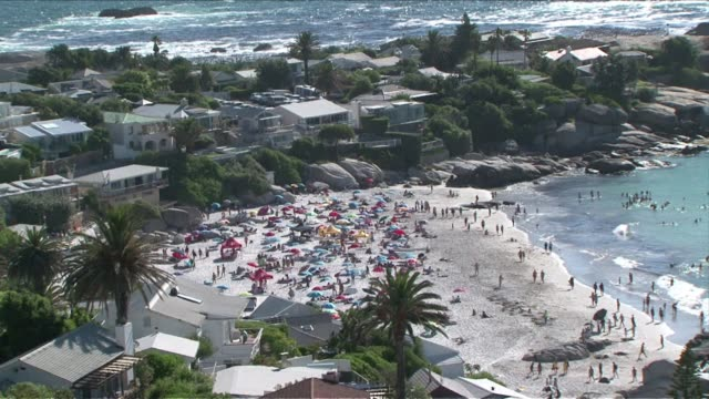 As South Africa's currency hits a fiveyear low foreign tourists converge on Cape Town to make the most of a cheaper holiday VOICED Tourists profit...