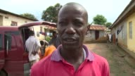 As the Ebola virus continues to ravage west Africa grave diggers in Sierra Leone risk contamination to bury dead