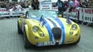 As the Le Mans 24 Hour race gets set for its 90th anniversary this weekend exotic racing cars old and new took part in a parade through the city as...