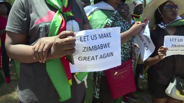 As thousands marched in Zimbabwe in support of the army and to demand Robert Mugabe's resignation dozens of immigrants gathered in Pretoria South...
