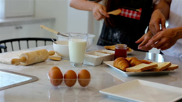 Asain Young couple preparing food in kitchen..Set scene