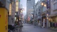Asakusa sidestreet w rickshaws.