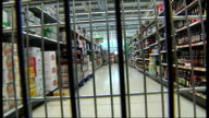 Asda interior general views POINT OF VIEW shot from inside moving trolley as wheeled up supermarket aisles showing shoppers and shelves of grocery...