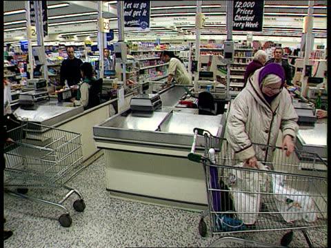 Asda LTN London People at checkouts at ASDA supermarket LTN