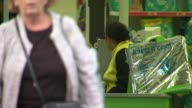 Asda supermarkets customers suffer after card payment system crashes ENGLAND London EXT Various of customers into and out of Asda superstore