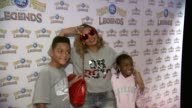 Ashanti and children at Ringling Brothers and Barnum Bailey Presents LEGENDS at Barclays Center of Brooklyn on February 20 2014 in New York City