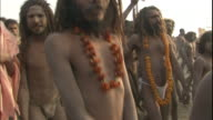 Ash-covered, garlanded Sadhus march towards Ganges, Allahabad, Uttar Pradesh, India