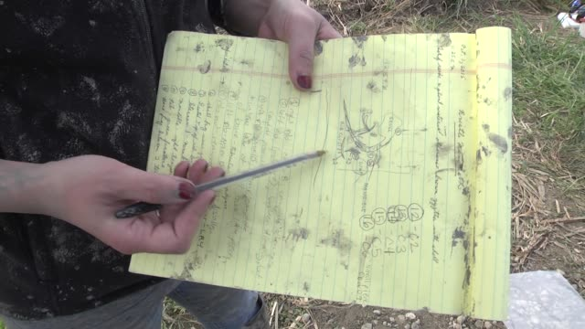 Ashely Lemke a researcher from the University of Michigan shows a drawing of the site where the skeleton of a mammoth was found buried on a Michigan...