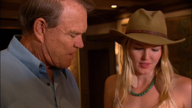 Ashley asks her dad Glen Campbell to sign a birthday card Glen has a memory lapse as they chat