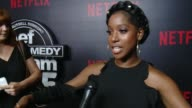INTERVIEW Ashley Blaine Featherson on how Def Comedy Jam influenced her on why Netflix is the best pose for this at Netflix Presents 'Def Comedy Jam'...