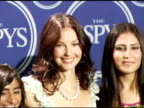 Ashley Judd presenter with Roia Noor Ahman and Shamila Kohestani of Afghanistan winners of the Arthur Ashe Award for Courage at the 2006 ESPY Awards...