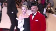 Ashley Olsen and Christian Louboutin at the 'Alexander McQueen Savage Beauty' Costume Institute Gala At The Metropolitan Museum Of Art at New York NY