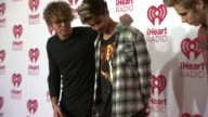 Ashton Irwin Calum Hood Luke Hemmings Michael Clifford at 2014 iHeartRadio Music Festival And Village Day 2 at MGM Grand on September 20 2014 in Las...